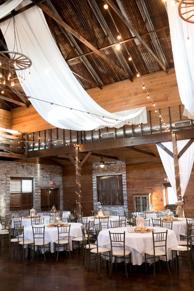 fabric draped wedding reception with twinkle lights