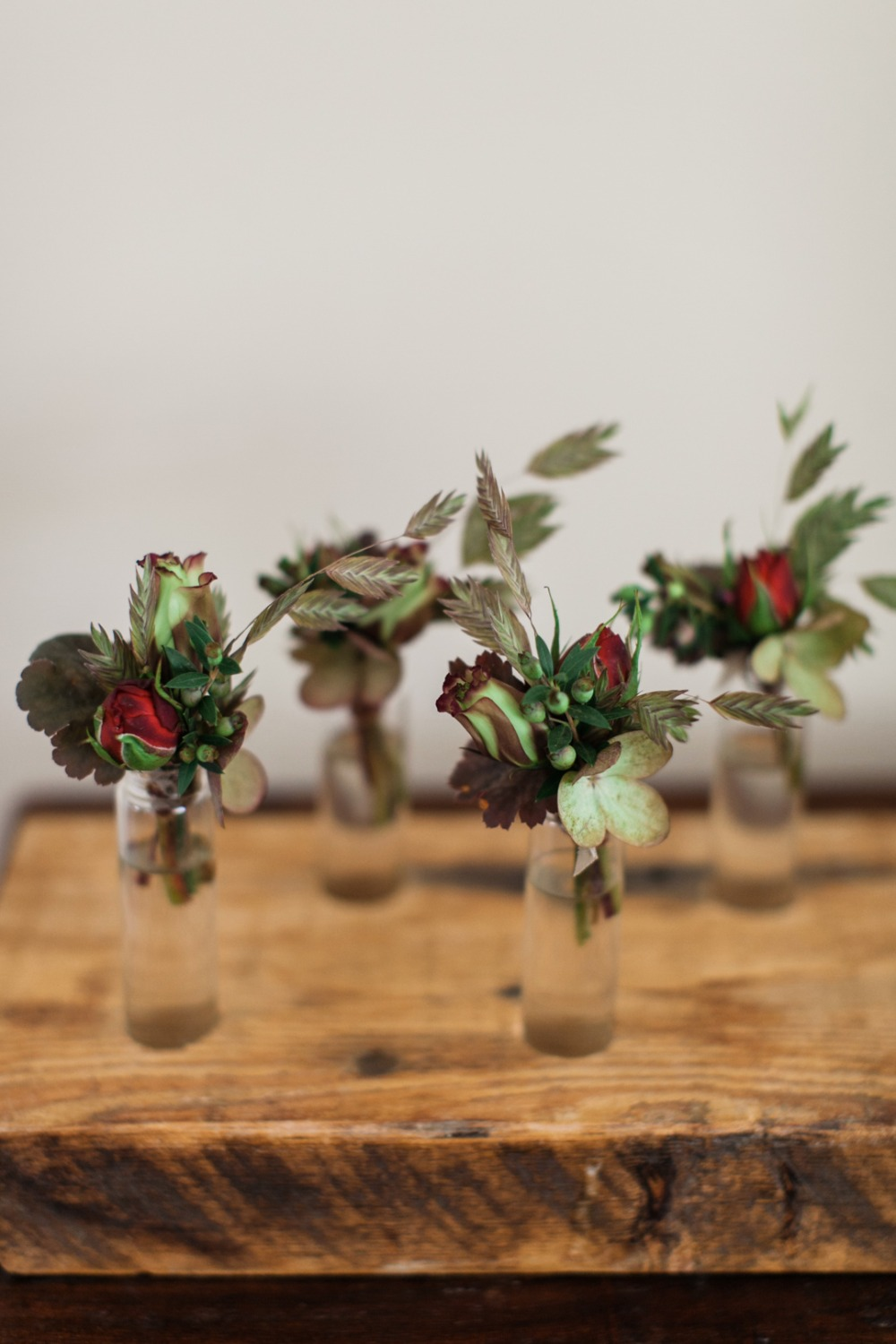 green and red boutonnieres