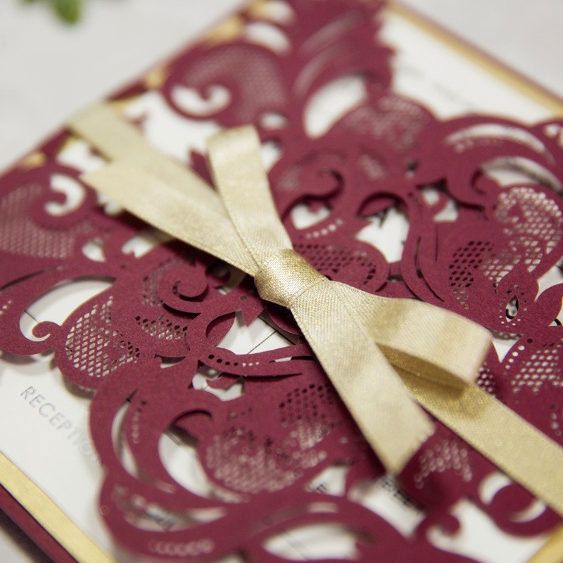 Intricate laser cut invitation from Stylish Wedd