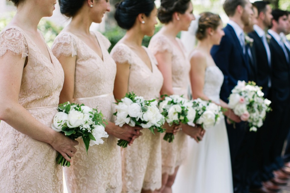 bridemaids in soft peach lace dresses