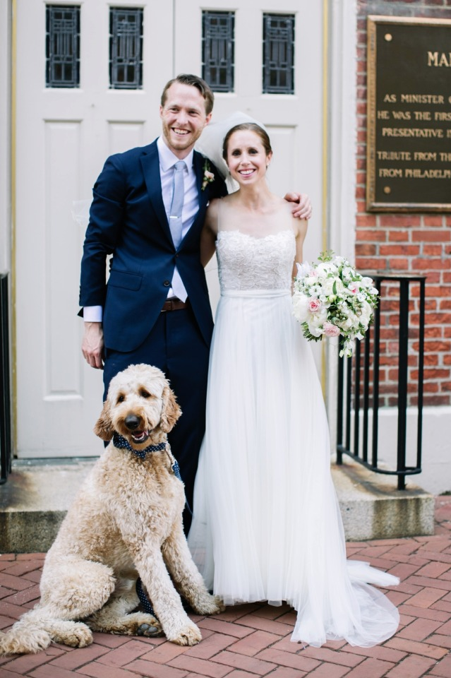 wedding dog and newly married couple