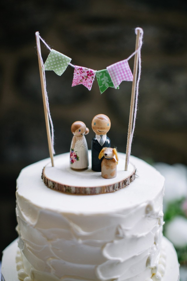 wooden people and dog cake topper