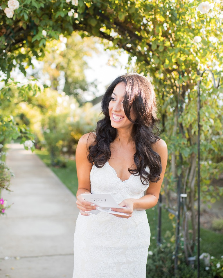 Bride reading a letter from her husband to be