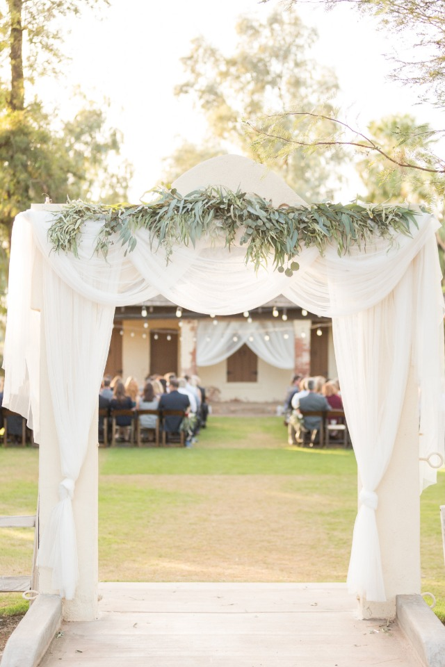 fabric draped wedding arch ceremony entry