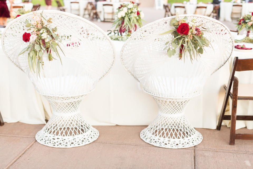 white wicker sweetheart table thrones