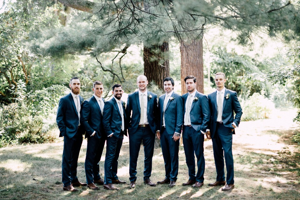 Dapper groomsmen in suits