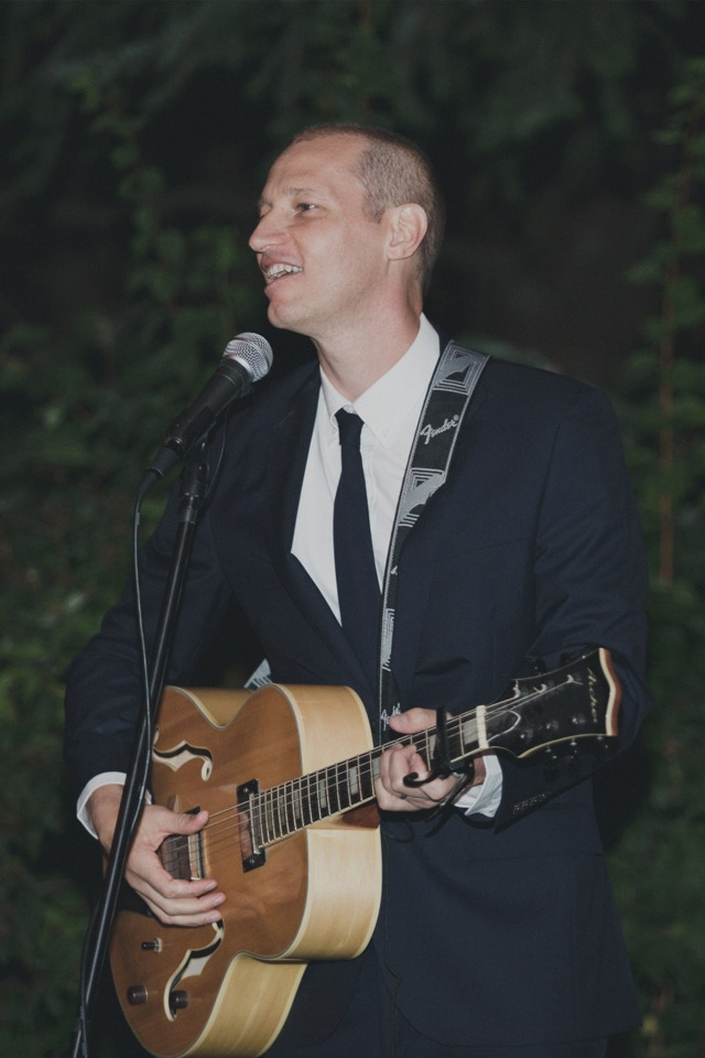 groom singing to his new wife