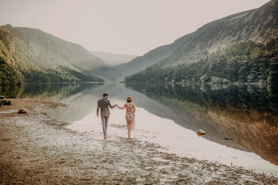 bride and groom playing in the water
