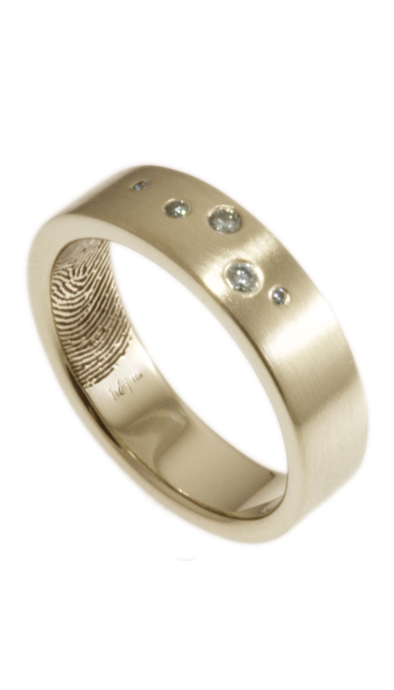 A little bit of sparkle with the intimacy of your actual fingerprint on the interior of the band. 10k white gold, 6mm wide, with 5