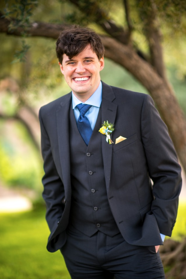 happy groom in three piece suit
