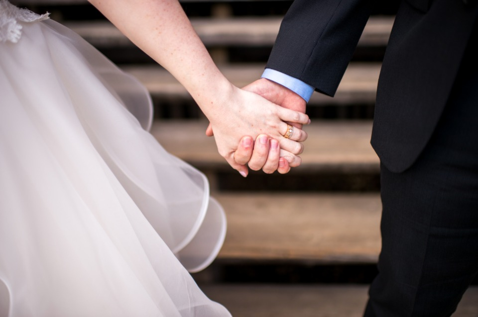 cute hand holding wedding photo