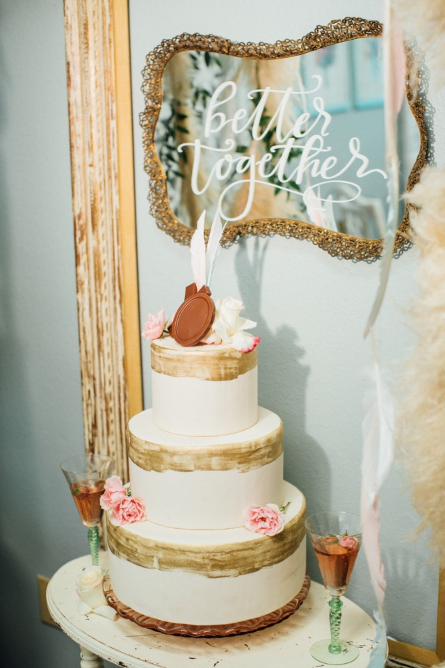 three tiered wedding cake with xo chocolate cake topper