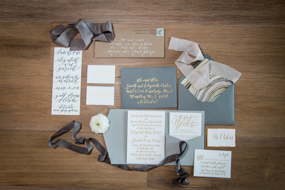 Blue and gold invitation suite