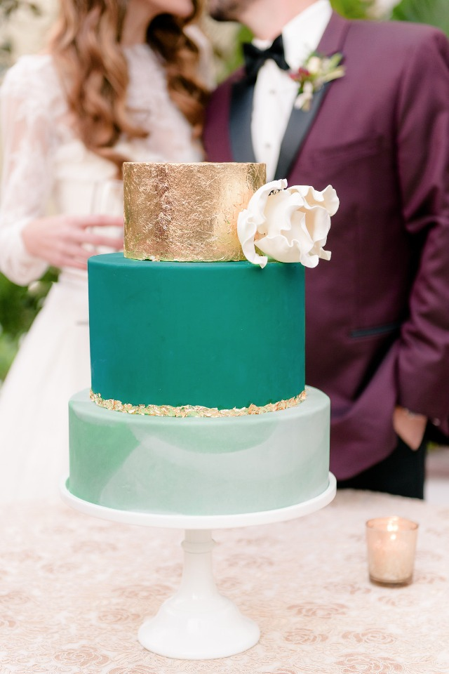 modern style wedding cake in gold and green