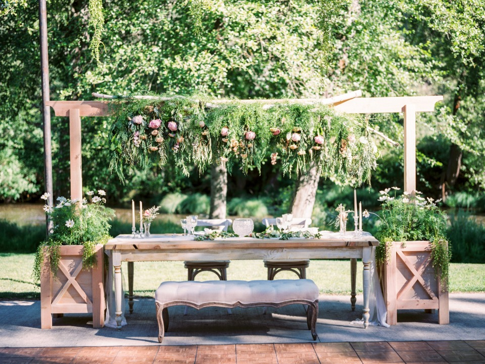 Oversized chic sweetheart table with bench for guests