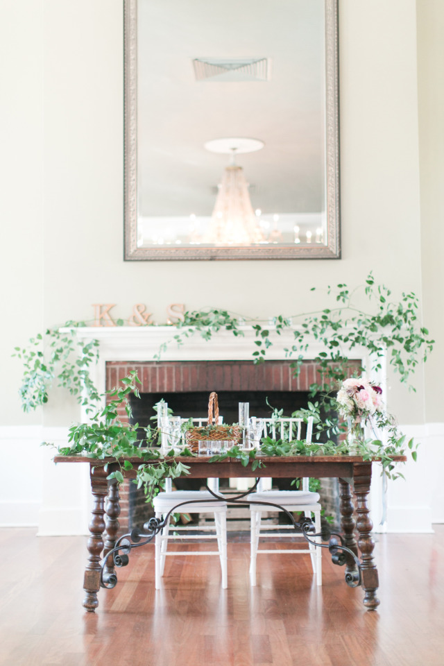 wedding sweetheart table in front of a fireplace