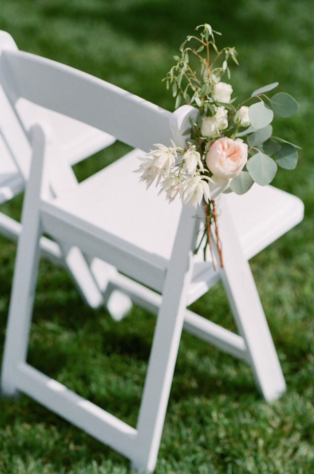 flower accented wedding chairs