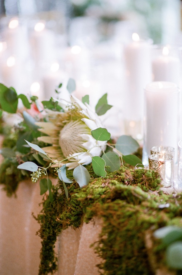protea and moss table decor