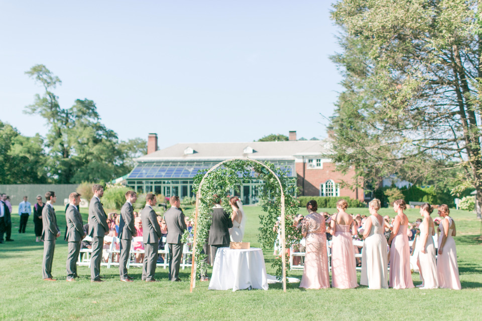 beautiful outdoor wedding ceremony with arch