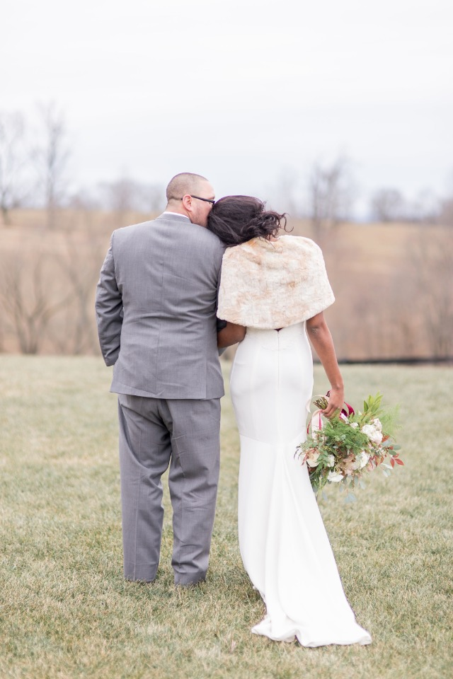 A fur shawl is perfect for a winter wedding