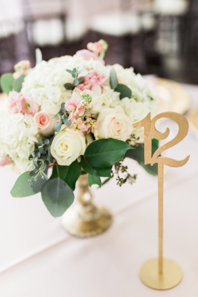 Beautiful centerpiece and gold table numbers