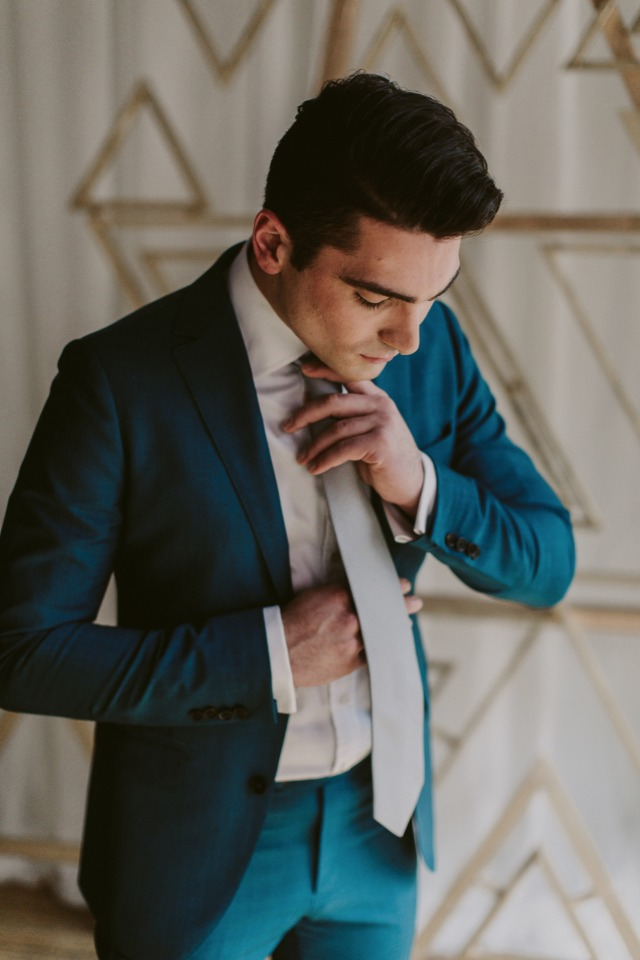 blue wedding suit for the groom in a silver tie