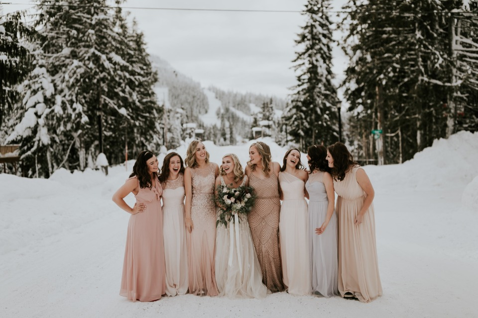 bride and her bridesmaids in blush and peach