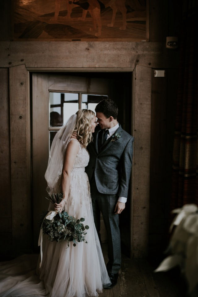 newlyweds in a winter lodge