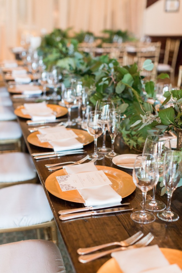 gold wedding place setting with organic centerpiece garland