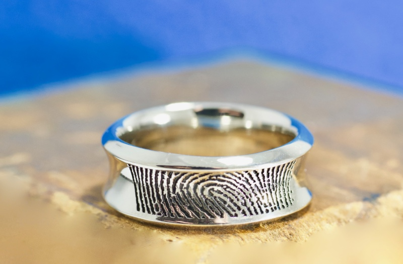 Forever touched with your fingerprint. The concave center protects the print from everyday wear and tear on this personalized ring