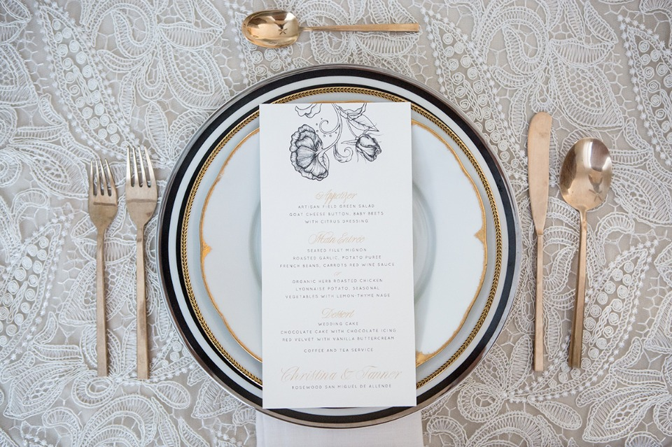 glam black gold and white place setting