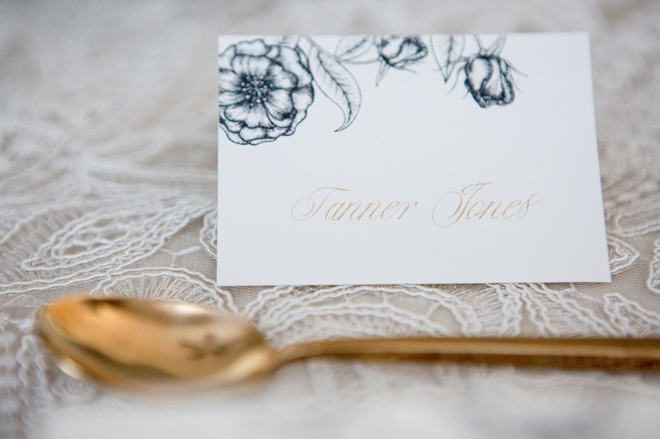 elegant escort card in gold black and white