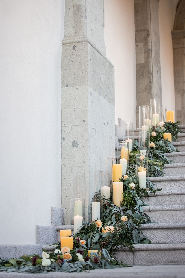 candle and floral garland staircase accent