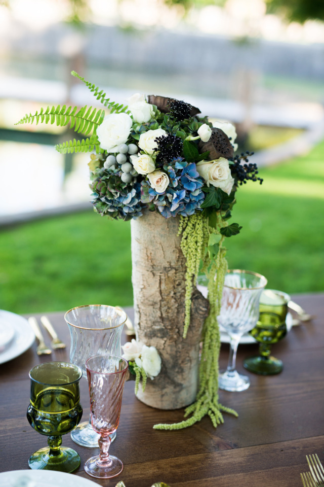 tall wedding centerpiece in wood vase