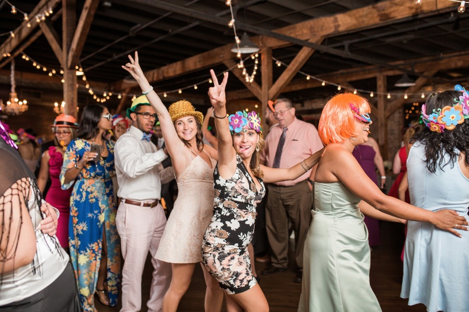 fun wedding reception with fun hats and props