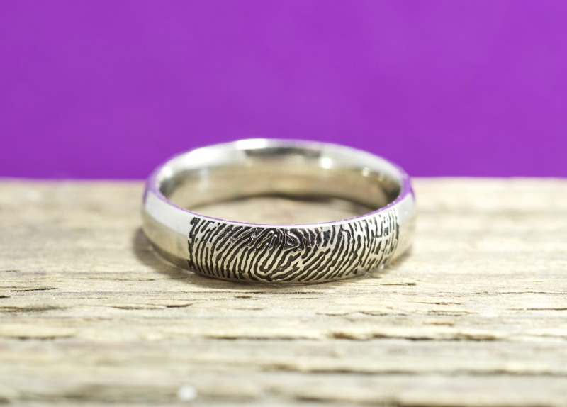 Handmade with your fingerprint. We can customize the band to your needs. This one was created in a 4mm width. Handmade by Brent&
