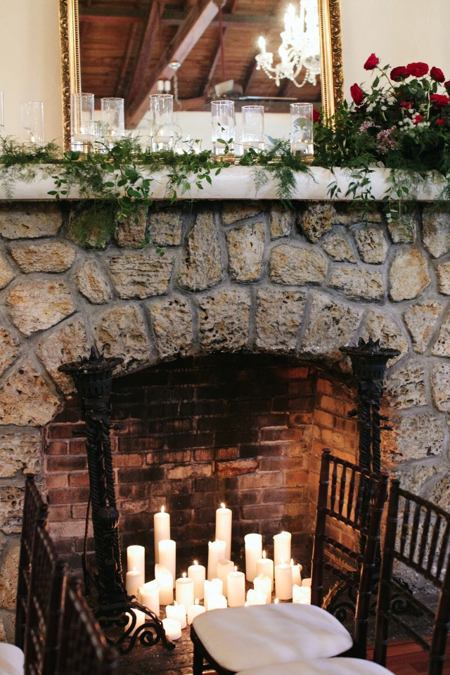 Fireplace filled with candles