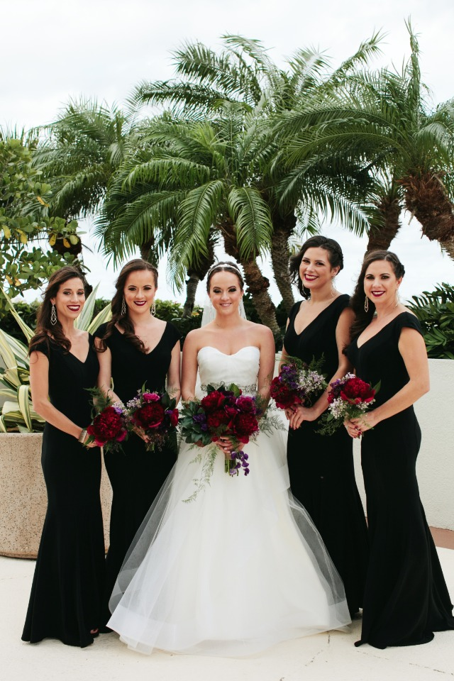 Love the bridesmaids in black dresses