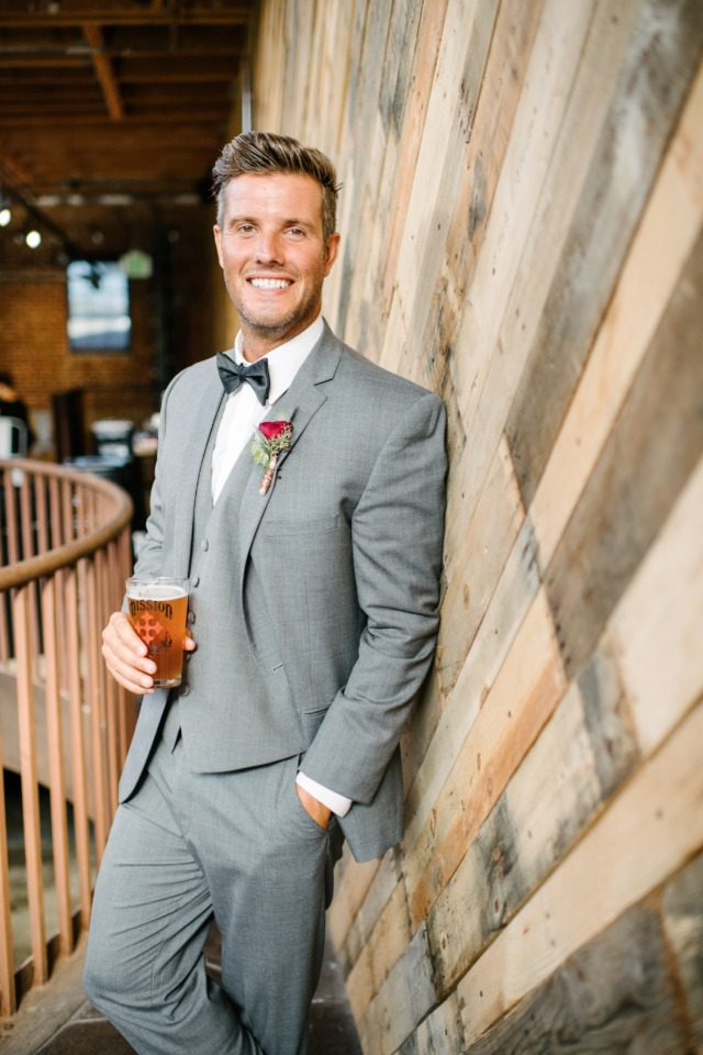 brewery groom in grey suit