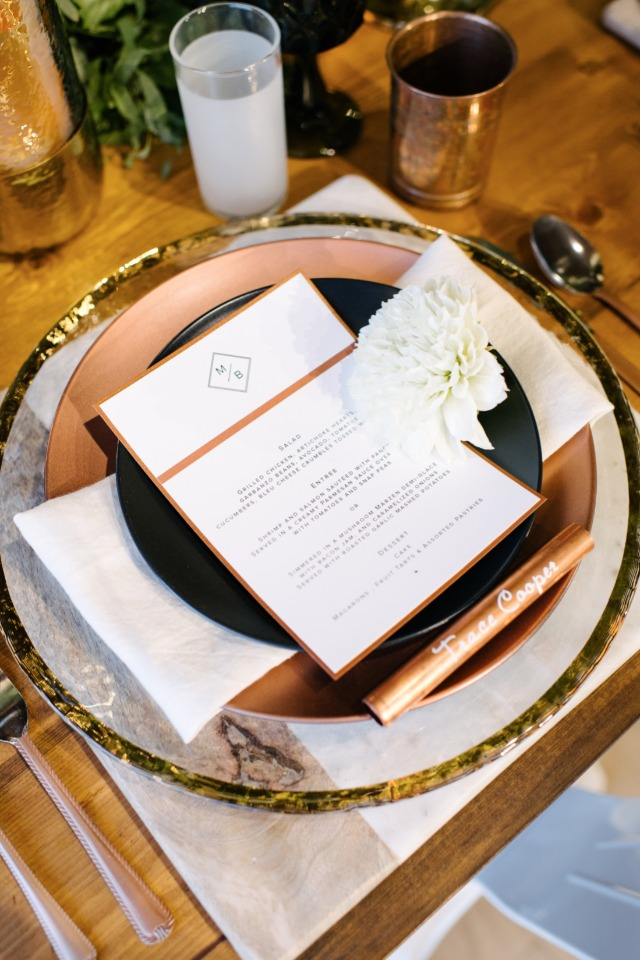 white copper and black wedding place setting