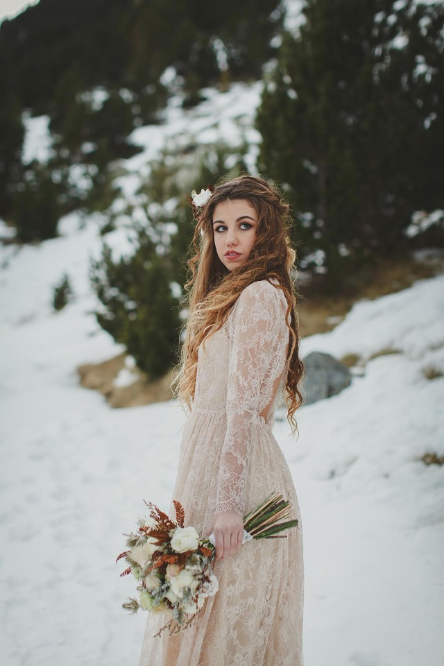 Boho winter bride in lace gown