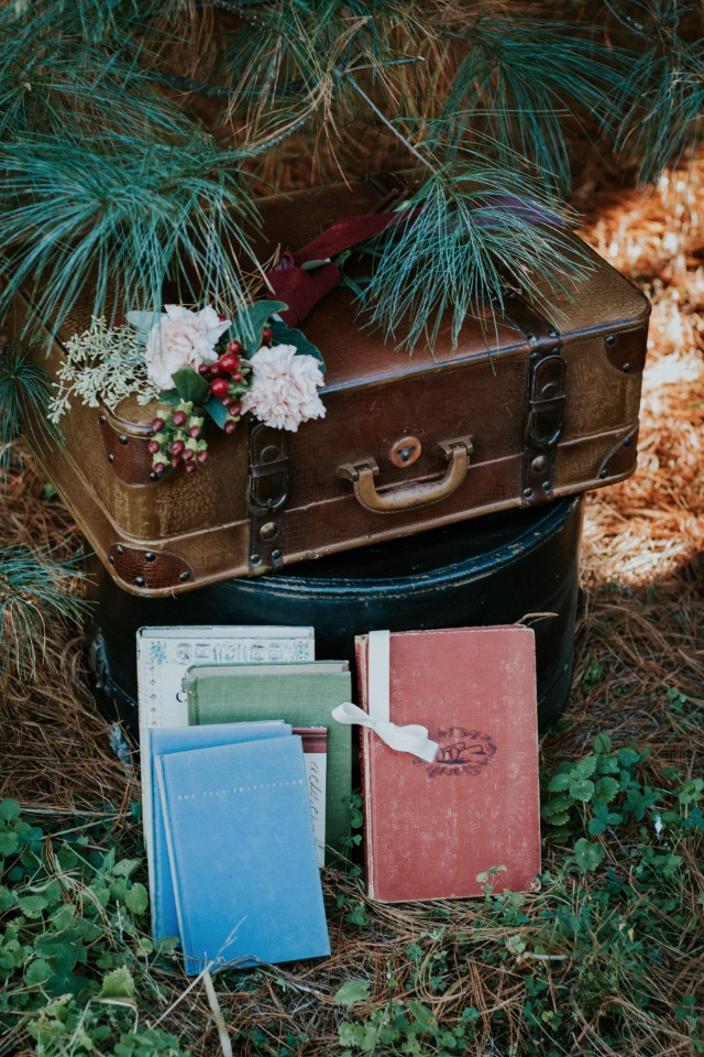 Vintage suitcase and books