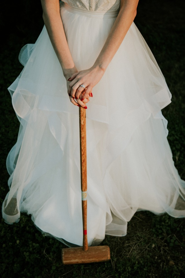 Bride playing croquet