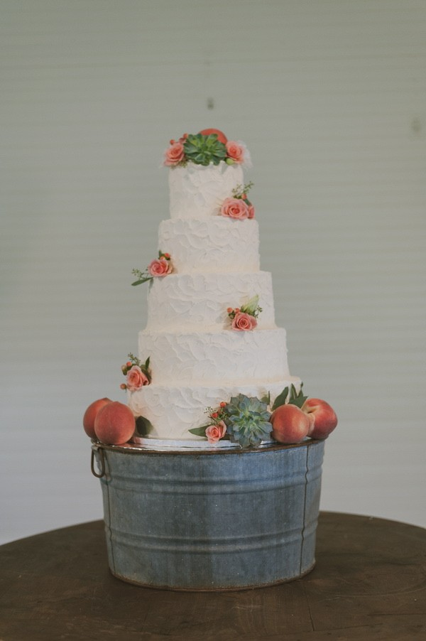 flower succulent and peach topped wedding cake