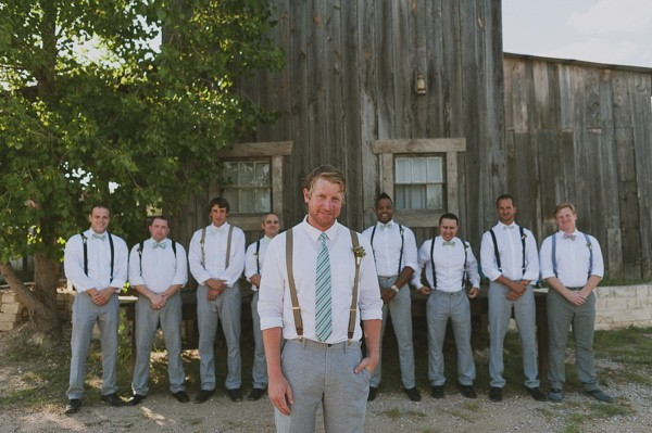 mint and grey groom and his men in suspenders