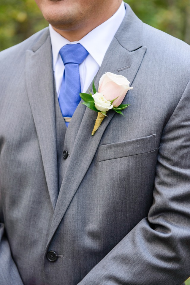 grey suite and blue tie