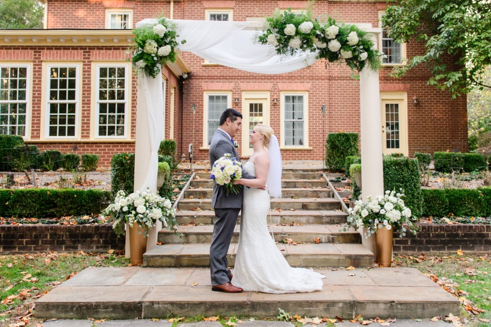 elegant flower accented wedding arch