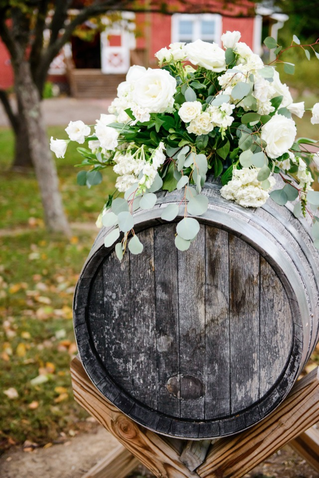 rustic barrel and flower wedding decor