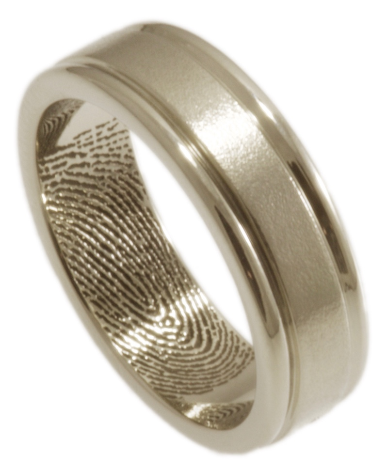 A modern wedding band with clean lines and your loved one's fingerprint on the inside. Handmade by Brent&Jess