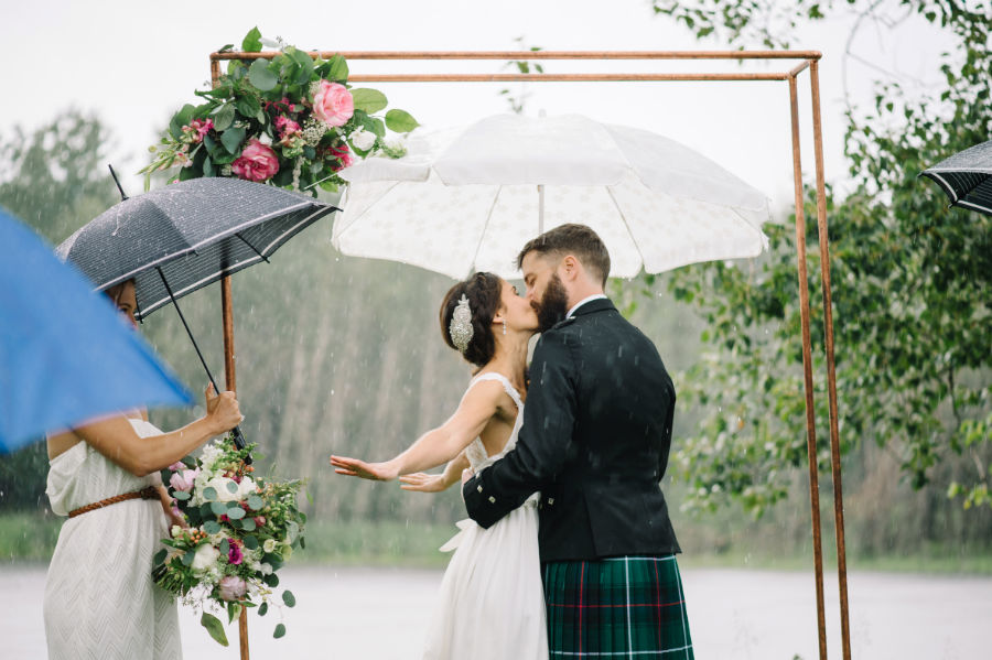 rain soaked wedding kiss